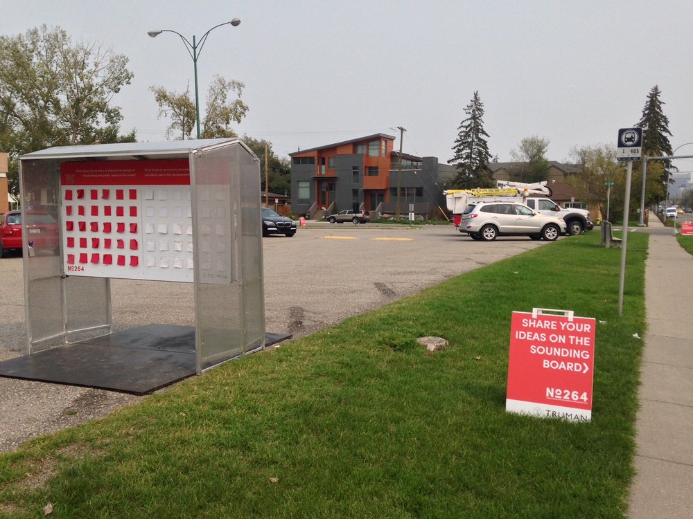 The City of Calgary and developers are both looking at different ways to inform and engage the public about proposed developments.  This was near the sidewalk and bus stop at the Kensington Legion. On the other side of the information booth was information on the proposed development.