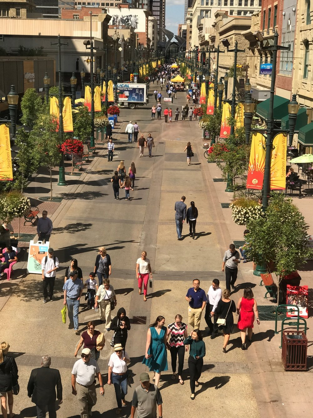 While most of downtown Calgary's streets are lined with office towers like Atlanta, Stephen Avenue Walk is a pedestrian mall by day and road at night. It is  a very popular place for office workers to stroll at lunch hour. It is line with patio and street vendors in the summer.
