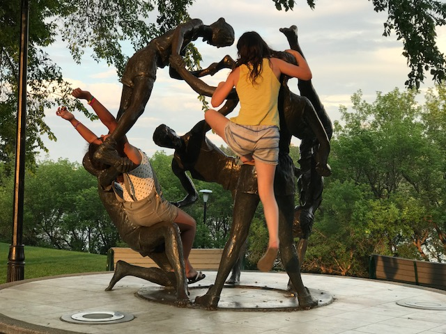 """Art imitates life"" or is it the other way around.  I love how these girls were inspired to climb and play with this piece by Saskatchewan artist William Epp titled ""Tribute to Youth"" created in 1989.  Public art should engage the public."