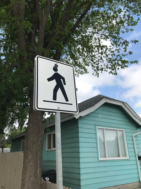 "I found a few of these fun top hat cross walk figures.  I love this kind of fun creativity.  It reminded me of ""Amplemannchen"" a cartoon-like human figure used in West Germany traffic signals for walk and stop."