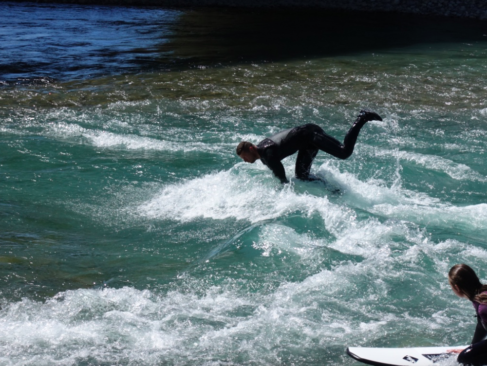 River surfing on the Bow River at the 10th St Wave is not easy....but fun to watch!