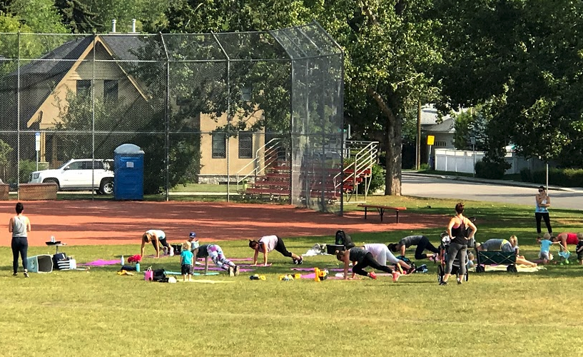 Tuesday morning yoga in the park with kids. You would never have seen this in the '60s.