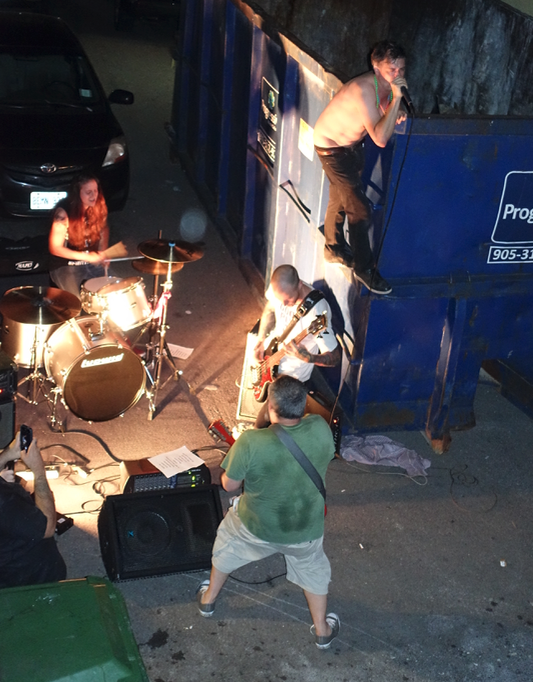 Found this grunge band playing in a dark back alley half a block off of James St N. Anything goes during SuperCrawl.