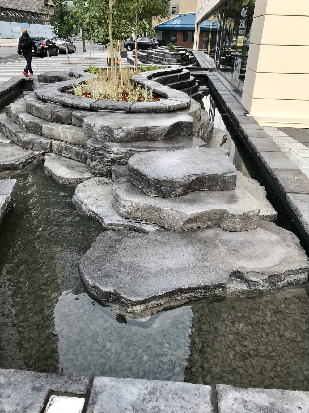 6th and Tenth's mini plaza and water feature were designed to enhance the pedestrian experience and be a meeting place for those living in the area.