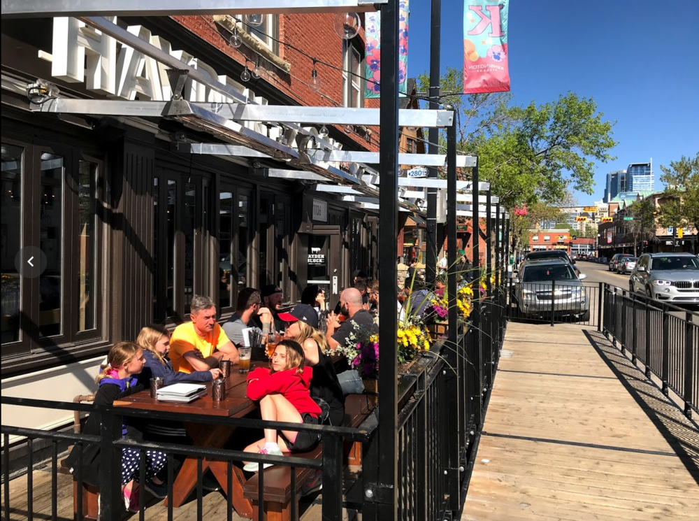 Summer patios are another way Kensington enhances the pedestrian experience.