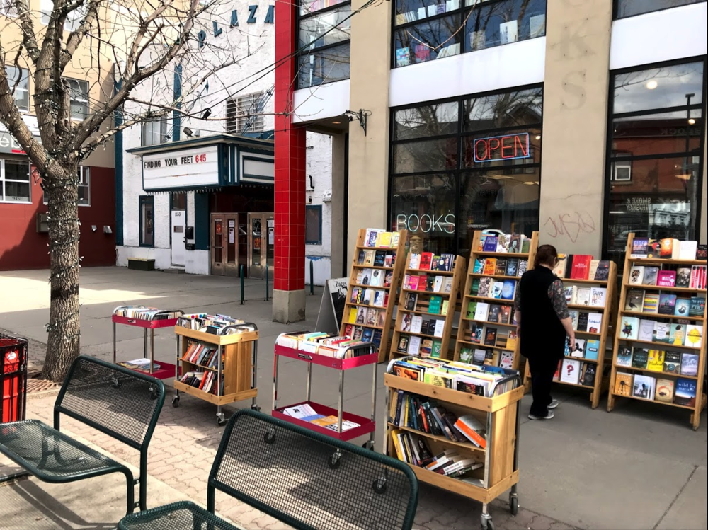Pages Books' enhances the sidewalk experience with its outdoor book displays.