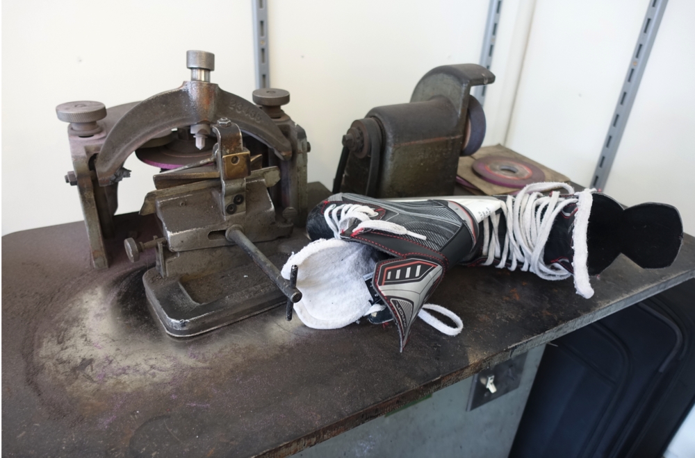 Vintage skate sharpening machine at Quinpool Shoe Repair is very cool.