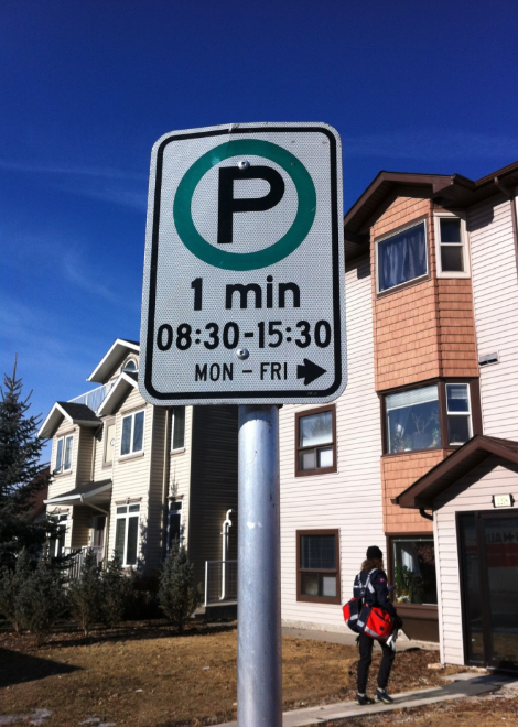 "I always smile when I pass by this ""One Minute"" parking zone in West Hillhurst."