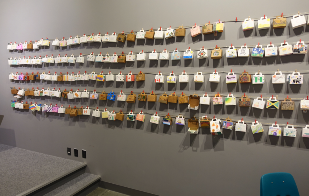 Pier 21 Fun: Loved this installation at Pier 21 where you were invited to decorate your own mini piece of luggage and then hang it on the wall. Another installation was of luggage tags where visitors were invited to write their stories of immigration or thoughts about their Pier 21 experience and hang them on the wall.