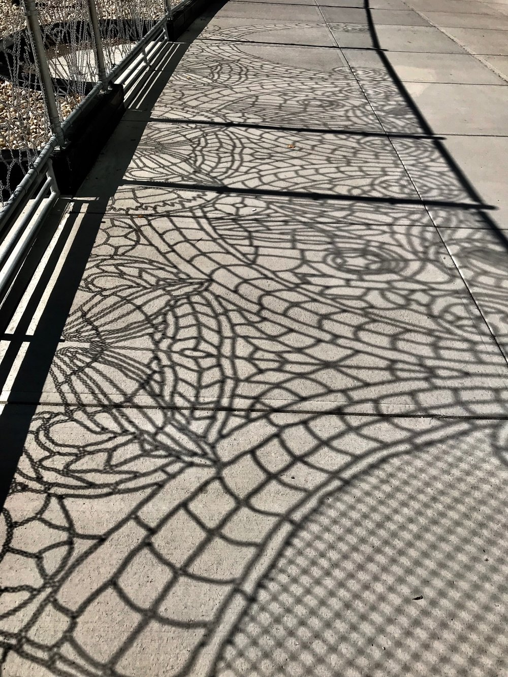 Found this strange shadow sidewalk art in downtown Calgary across from the Bow office tower. It is created by the ornamental chain-linked fence that surrounds a future building site. Kudos to the developer (I expect with some push from the City) to create something more ornamental vs ordinary. More of this in 2019 please!
