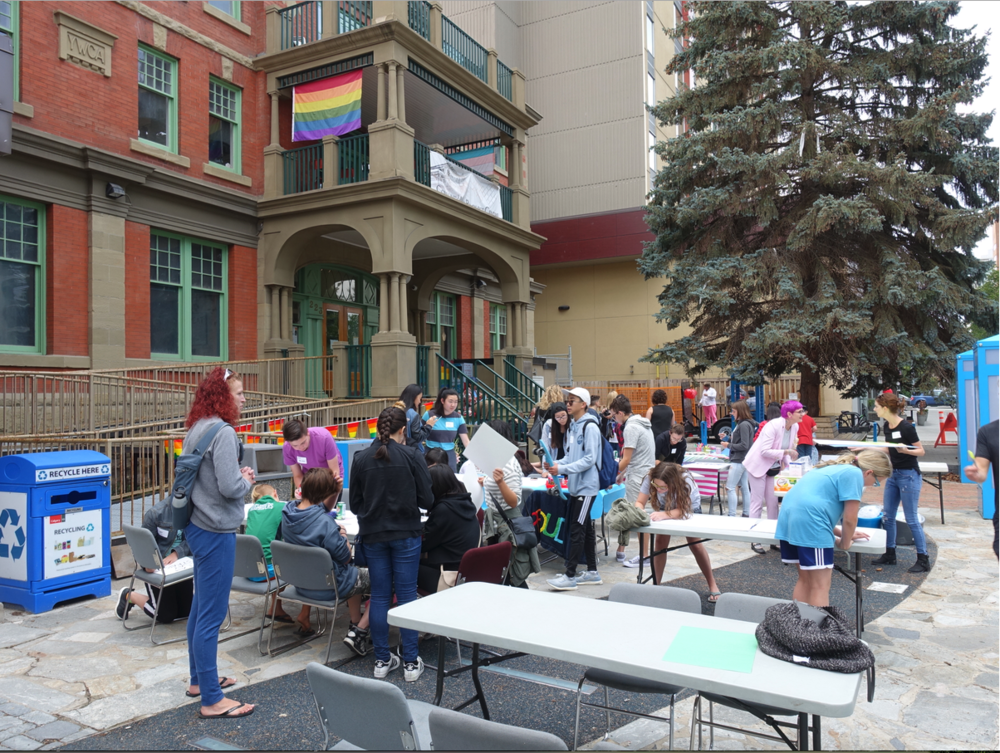 Decorating party for Pride Parade float at the Beltline's Aquatic & Fitness Centre