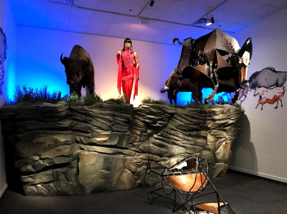 "Kent Monkman's installation titled, ""The Rise and Fall of Civilization"" with its three figures at the edge of a cliff makes multiple references to civilizations past and present."
