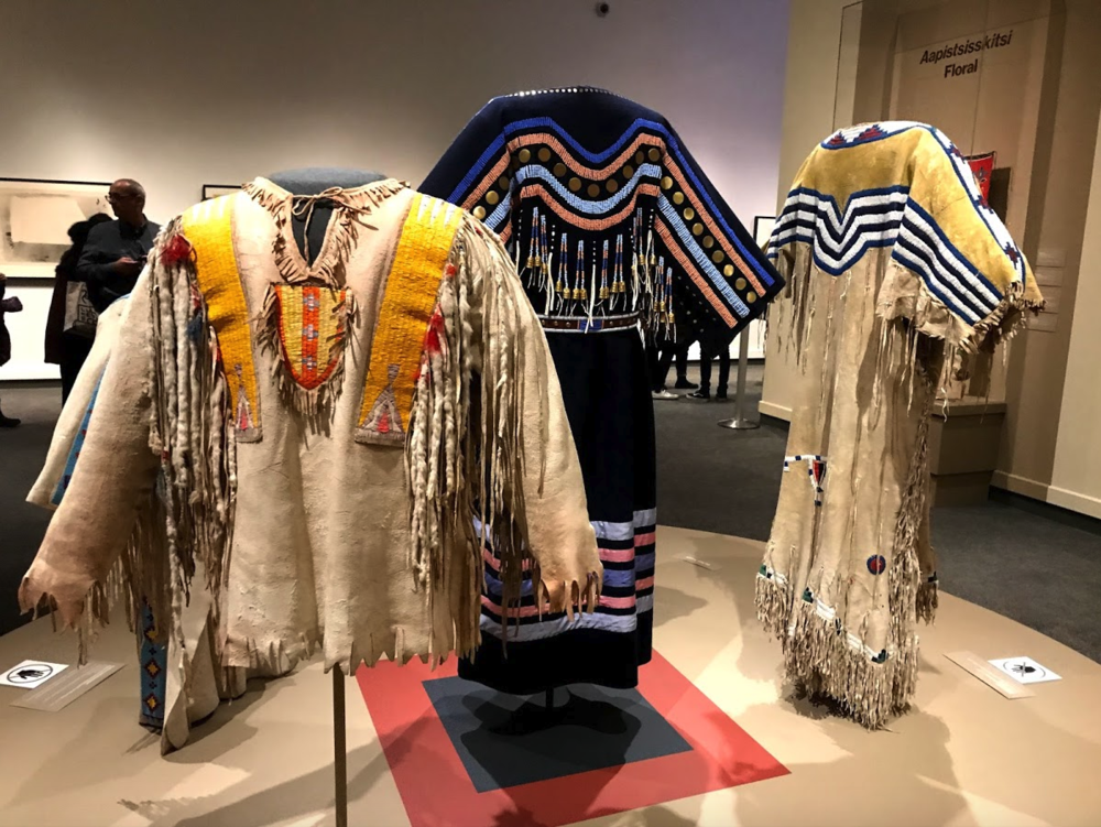 The exhibition of Blackfoot traditional clothing is a clever juxtaposition to the Christian Dior exhibition.