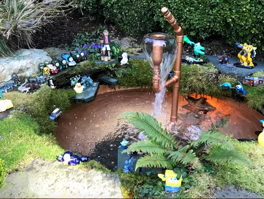 This fairy garden in the West End created from kids toy figures was delightful. I am thinking I have to create a fairy garden this spring to entertain the children being dropped off in front of our house for the Honey Bee Daycare across the street. I must practice what I preach.