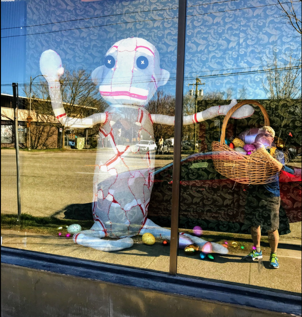 I included myself in this photo so you could appreciate how big this sock monkey aka Easter Bunny is. I love streets with quirky window displays.