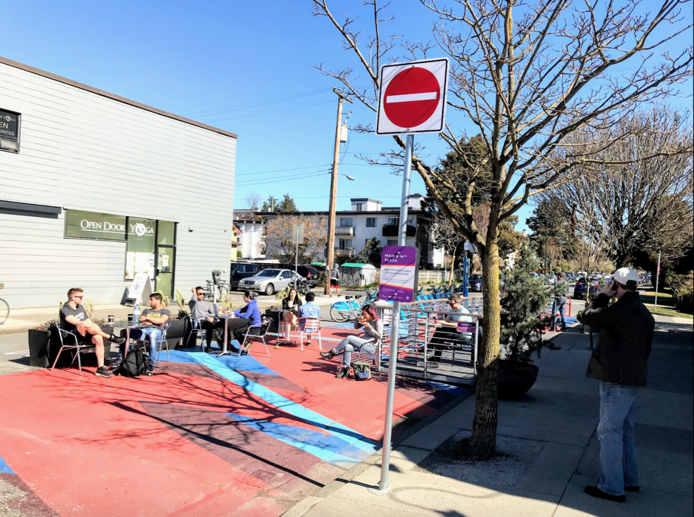 I love the simplicity of just closing off half a block of this side street to create a community gathering place. It is also a simple and effective way to prevent traffic from cutting through the neighbourhood.