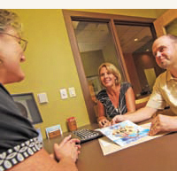 Doctor Chris Sierk and Treatment Coordinator Marie Ramme discuss treatment options with a patient.   Photo by VERN UYETAKE