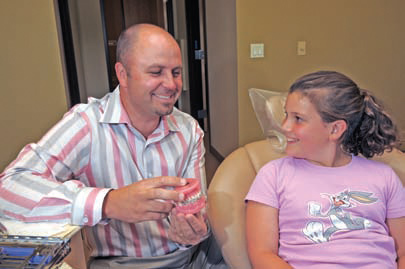Dr. Christopher Sierk discusses the procedure with West Linn patient Jacqueline Harris.