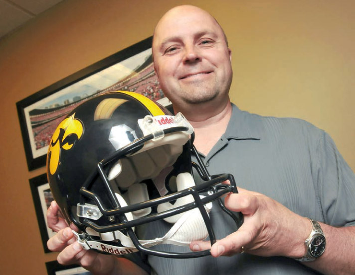 A native of Iowa, Dr. Chris Sierk is a diehard Iowa Hawkeye fan.
