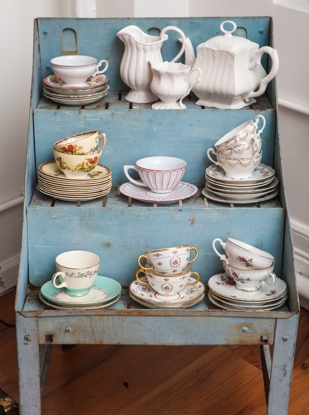 TEA CUPS ON PLANT RACK
