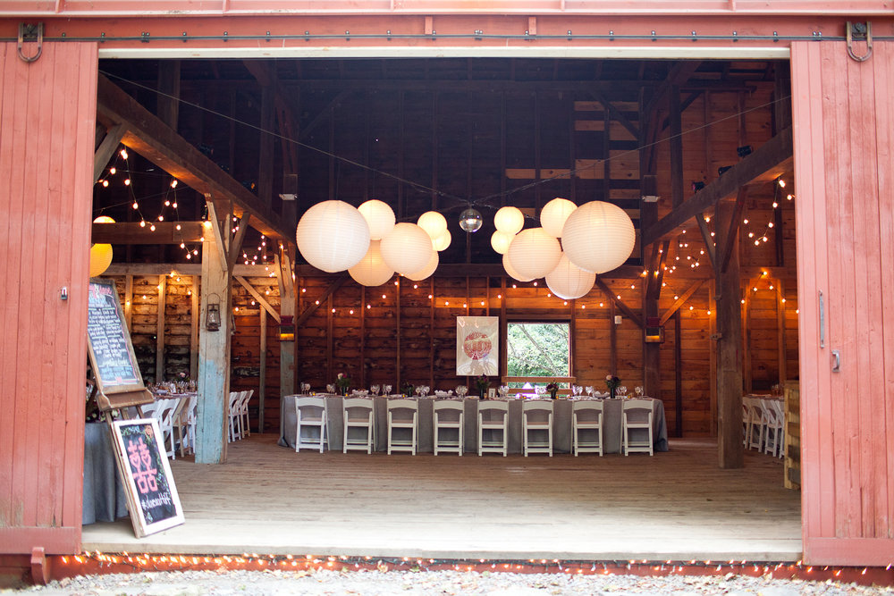 BARN SET AND LIT WITH TWINKLE LIGHTS AND PAPER LANTERNS