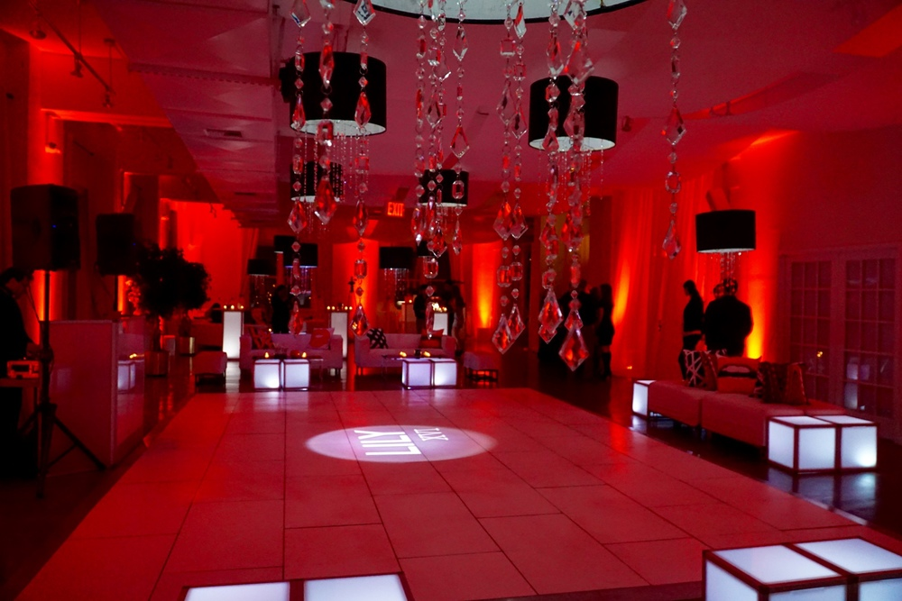 LED OTTOMANS SURROUND THE DANCEFLOOR