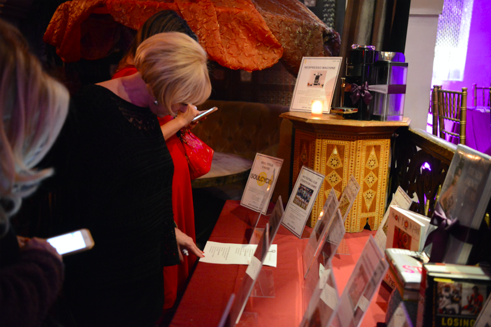 Guests inspecting the auction items