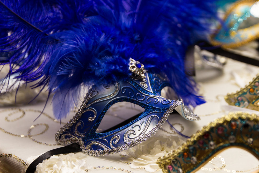 Royal blue mask with metallic silver trimming and feathers