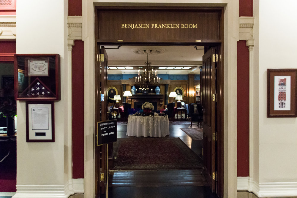 Heavy wooden doors of the Benjamin Franklin Room leading to the reception