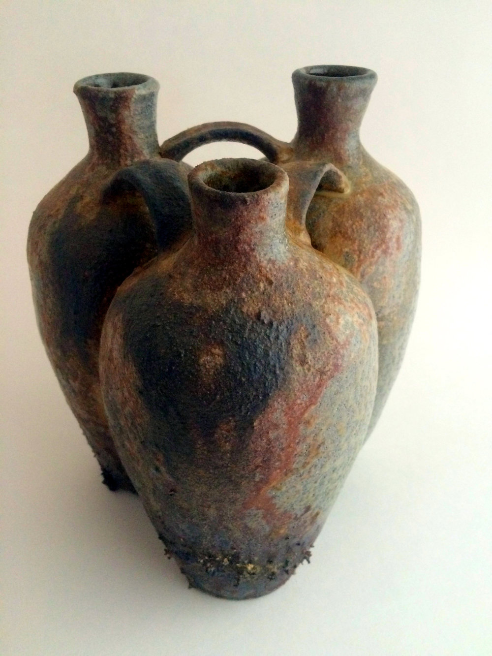 Wood-fired conjoined jug with heavy ash deposit from 2015
