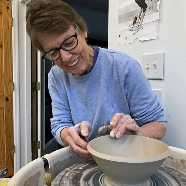 Caroline Montague  Wet spinning clay on the wheel:slurry sliding through fingers, plastic and stretching, responds to centering and forming. A shape emerges; echoing movement and rhythm of creeks, tides, Sun and Moon. I love this Earth. Stars in the night, the alchemy of the gas kiln fire and celebrating this atmosphere among other potters, sustains my creativity.