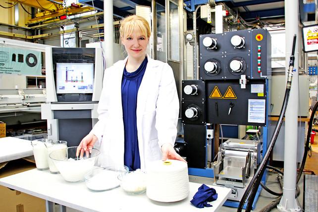 Anke Domaske pictured with milk casein fiber.