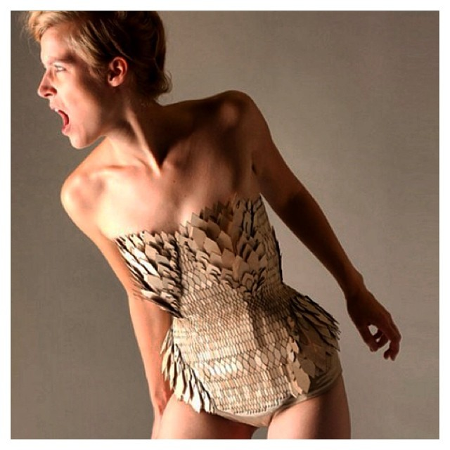 How awesome is this reptilian inspired bodysuit? Check out our blog for more info on Stephanie Nieuwenhuyse's biomimetic fashion designs! #biomimicry #biology #bodysuit #fierce #ecofashion