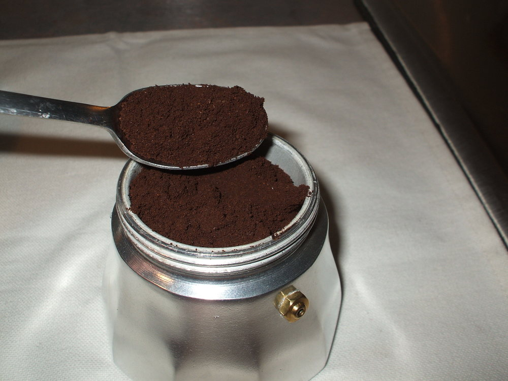 Fill funnel with ground coffee