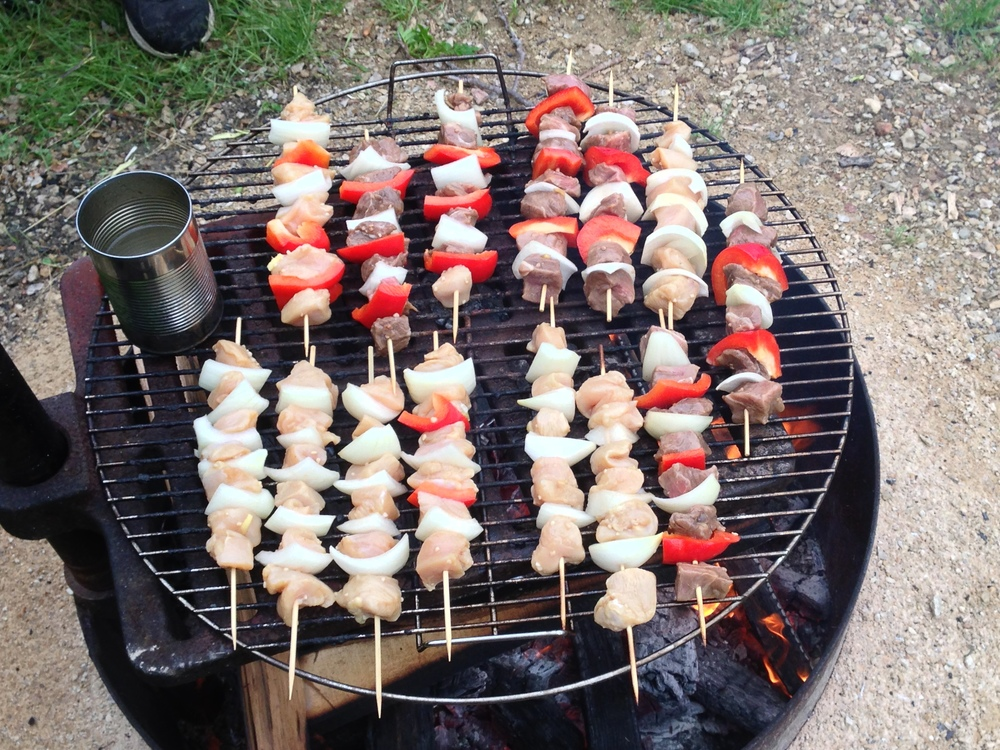 Cooking kabobs over the fire during another light drizzle.