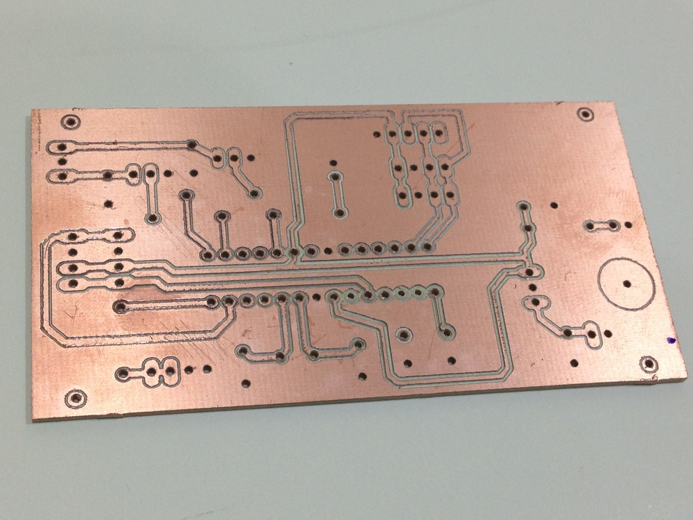A circuit board hot off of the CNC mill