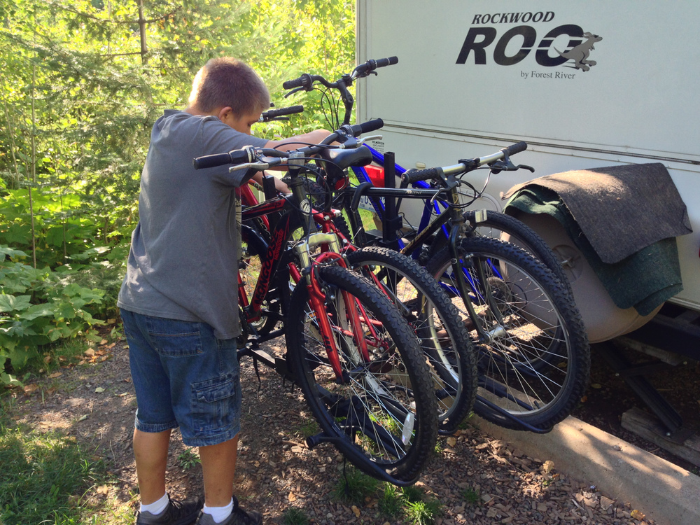 Ben working on the bikes on the back of the camper