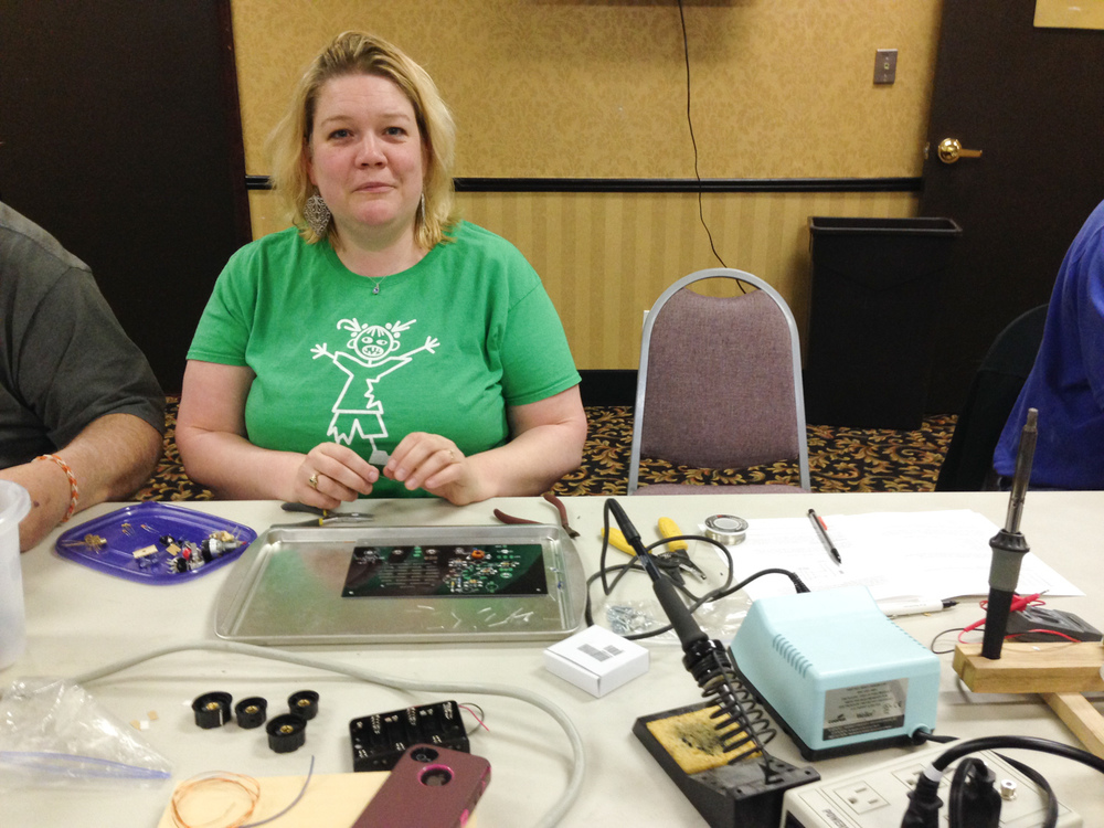 Cristy working on the regen receiver project. First time soldering since high school and she did a great job.