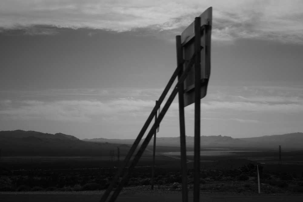 A lone highway sign between Las Vegas and Los Angeles Black and white