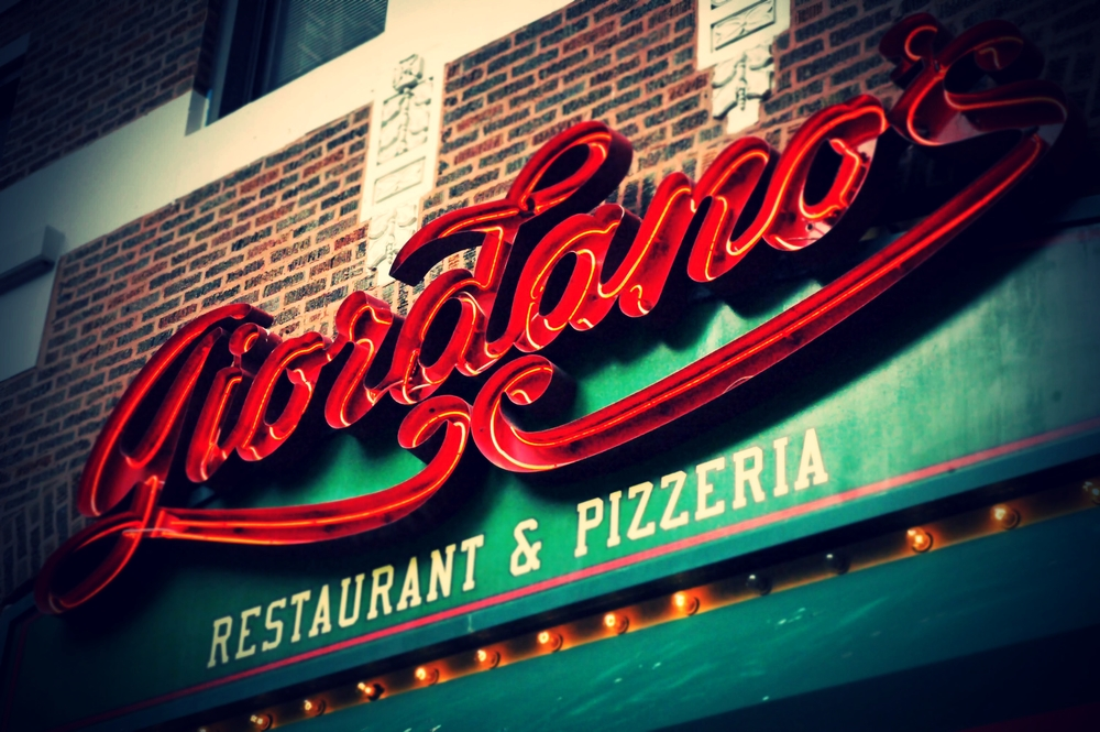 "GIORDANO'S is located one block from Chicago's Magnificent Mile, Giordano's World Famous Stuffed Pizza is Chicago's leader in stuffed deep-dish pizza.  As Giordano's states, they are ""stuffing America one pie at a time.""  Check out the photo, which is an accurate reflection of what you can expect from one of the cheesiest stops on our pizza tour."