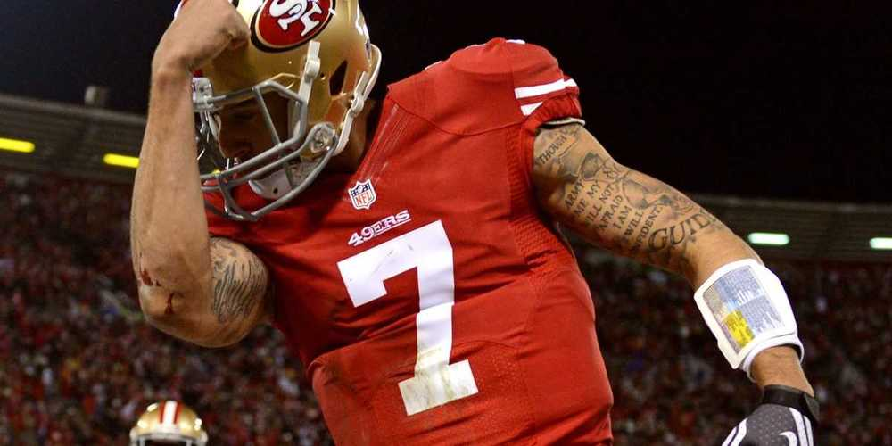 COLIN KAEPERNICK , SAN FRANCISCO 49ERS  (Harry How/Getty Images)