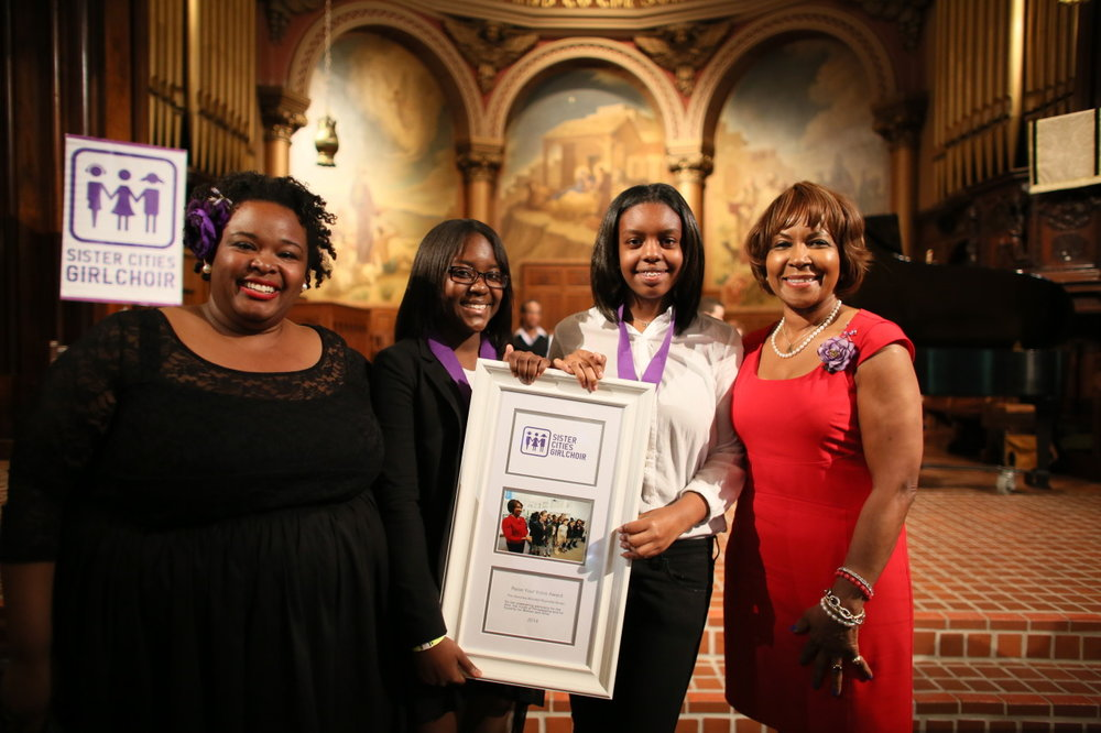 "Sister Cities Girlchoir Founder Alysia Lee presents Philadelphia Councilwoman Blondell Reynolds Brown with the first annual ""Raise Your Voice Award"" in recognition of her commitment to ""raise her voice"" for arts, culture and children."