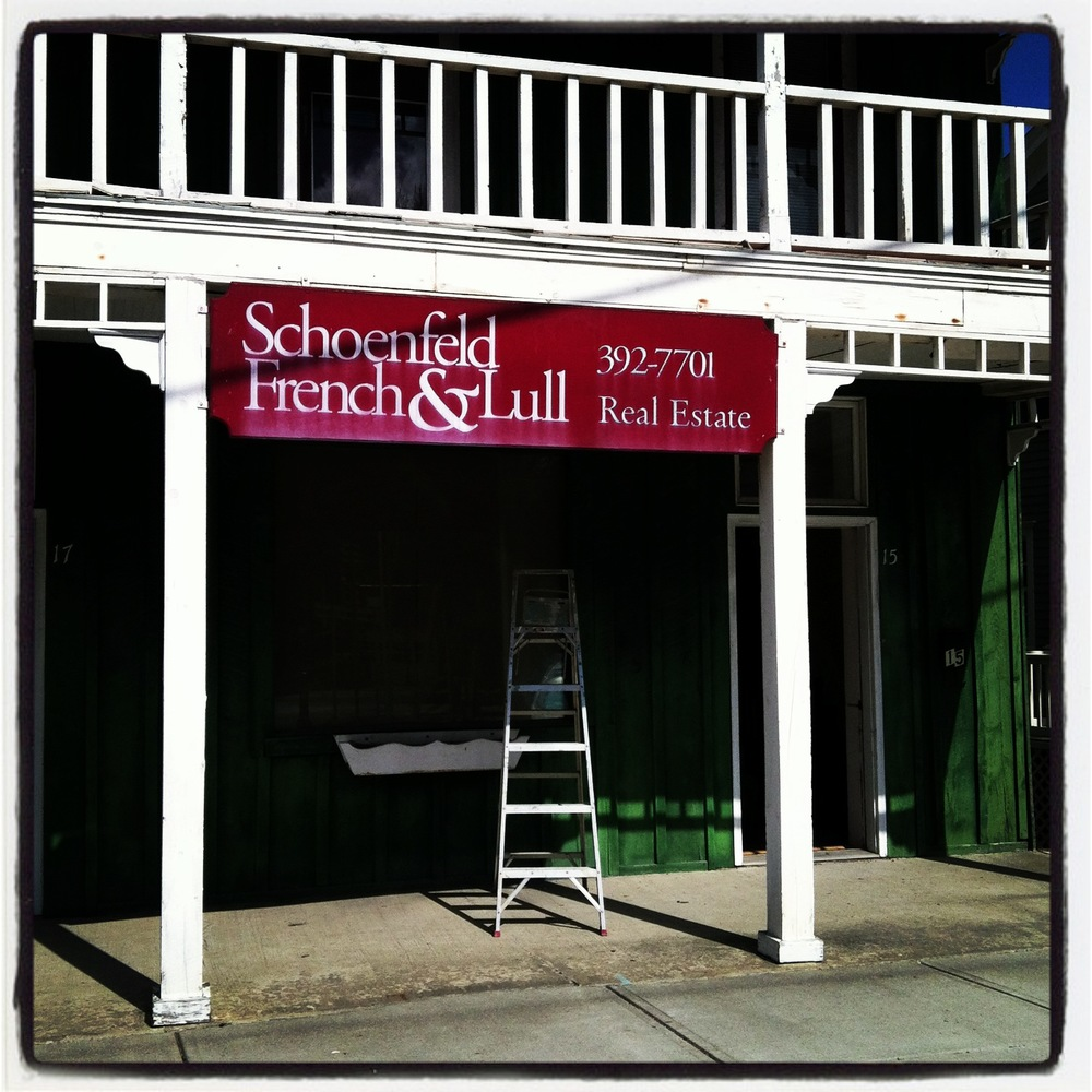 A beautiful day for removing the Schoenfeld French & Lull Realty sign... a long time business in the community.