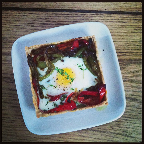 Peppers and onions with cumin, coriander and yogurt baked with an egg in savory pastry.