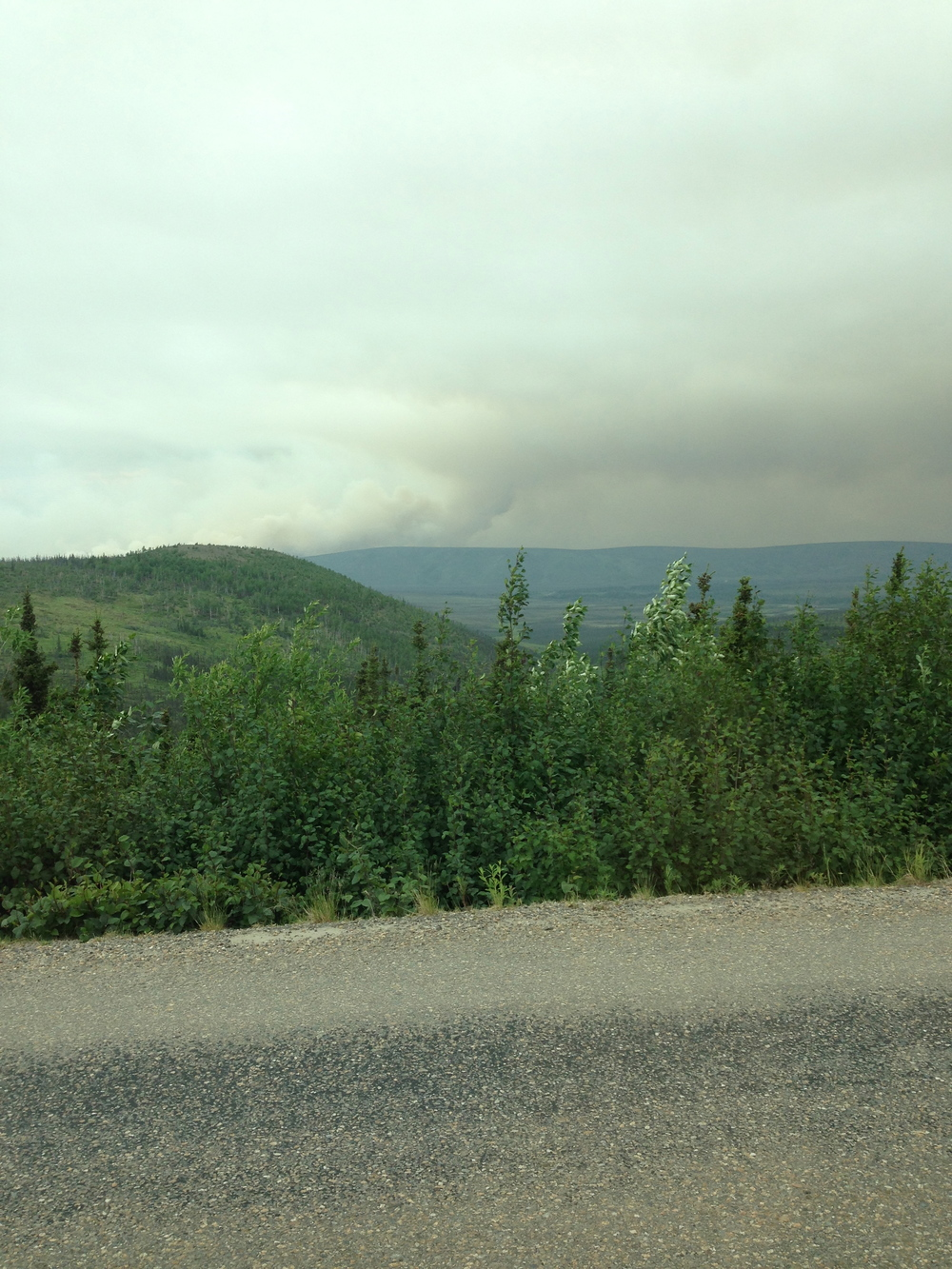 This is smoke from a fire we observed from the Dalton Highway. This fire is currently about 400 acres large. I was informed this is relatively small in the scale of Alaska fires!