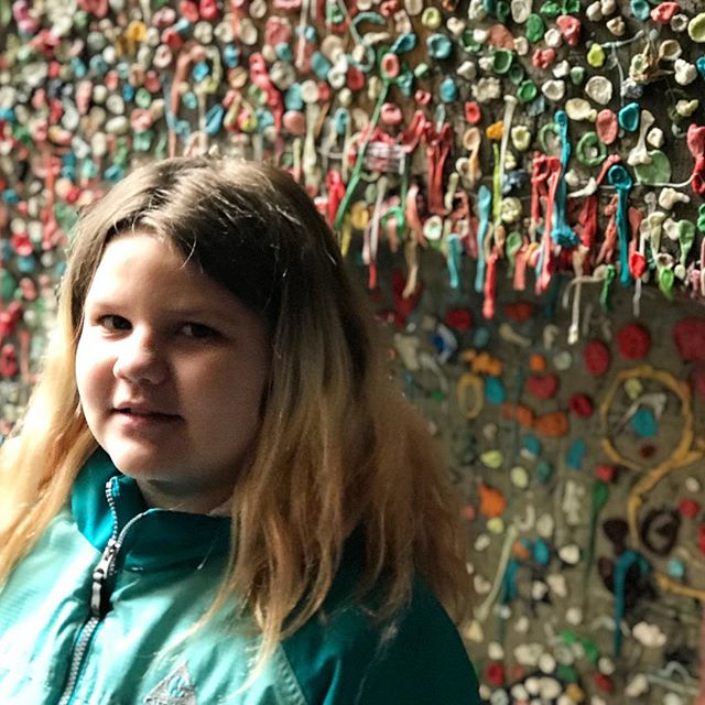Scarlett takes a pic in front of the famous Seattle Gum Wall. #gumwall #seattle