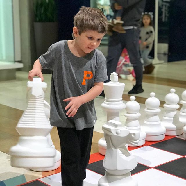 Adam plays a game of big chess in #seattle while repping #pdx in his @portlandgear shirt.