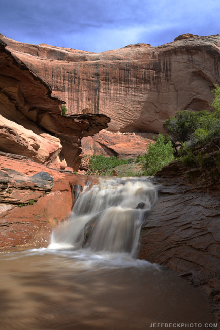 Coyote Gulch has soaring walls and a sculpted streambed.