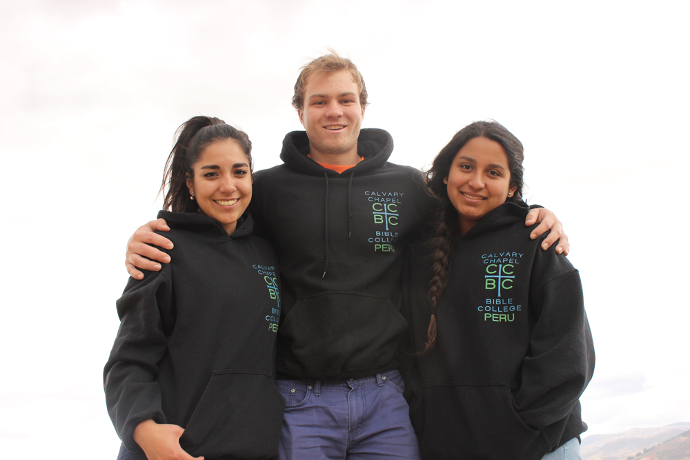 Yamali, Jesi and Anna pose to let you see the design for the new CCBC Peru Sweatshirt