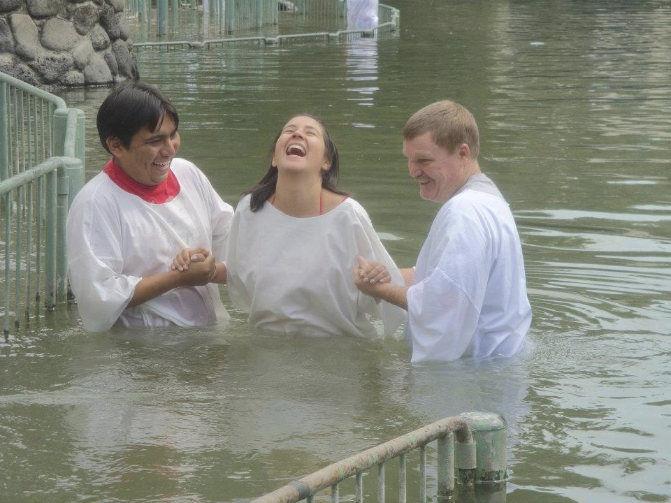 Baptizing Ecuadorian student Sandy Fajardo in the Jordan River.  What a joyful experience!.jpg